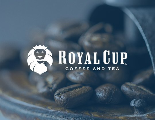 Royal Cup Logo with Coffee beans in background