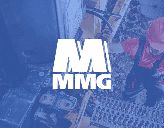 MMG Logo with Mining employee working in background