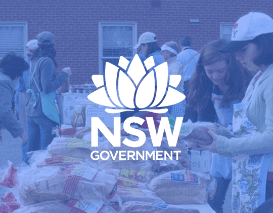 NSW Goverment Logo with Government officials helping in background